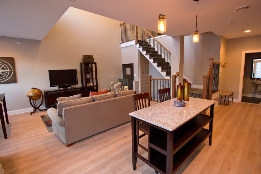 "View of the living room in ""The Empire"" apartment unit at The Lofts At Saratoga"