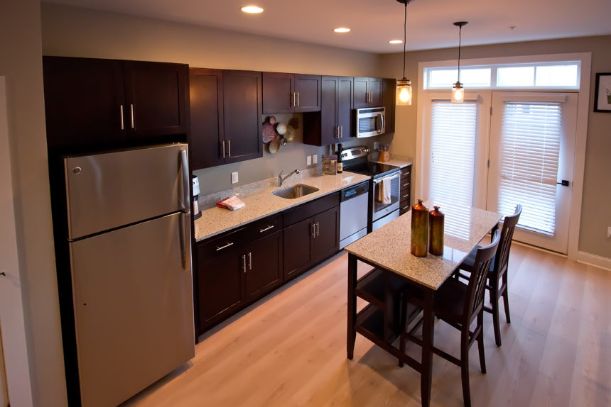 "Kitchen in ""The Empire"" apartment unit at The Lofts At Saratoga"