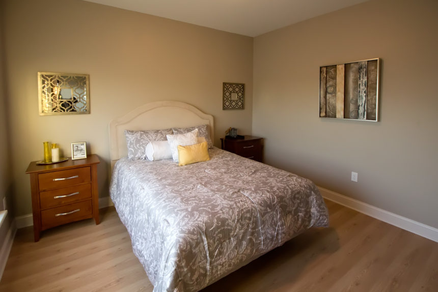 "Master bedroom in ""The Empire"" apartment unit at The Lofts At Saratoga"