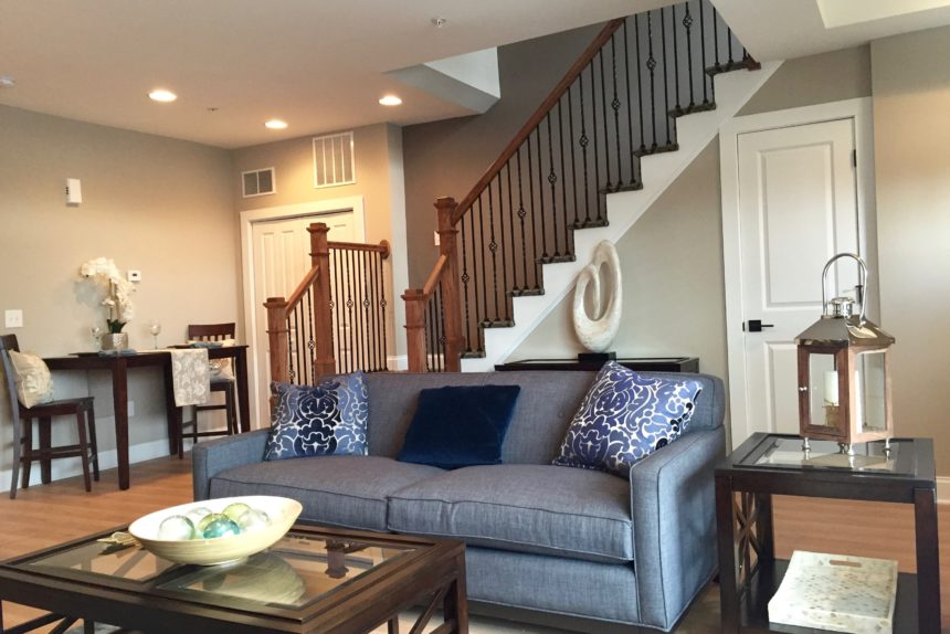 """Living room and first floor staircase in """"Paddocks"""" unit at The Lofts At Saratoga"""